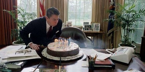 Ronald Reagan blowing out birthday cake